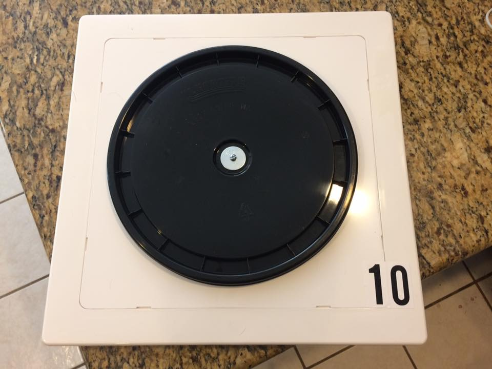"Another DIY approach we have seen is a  12"" bucket lid  stuck on a white plastic  14x14 access panel . Each of these are available at Home Depot, Lowe's, or your local hardware store."