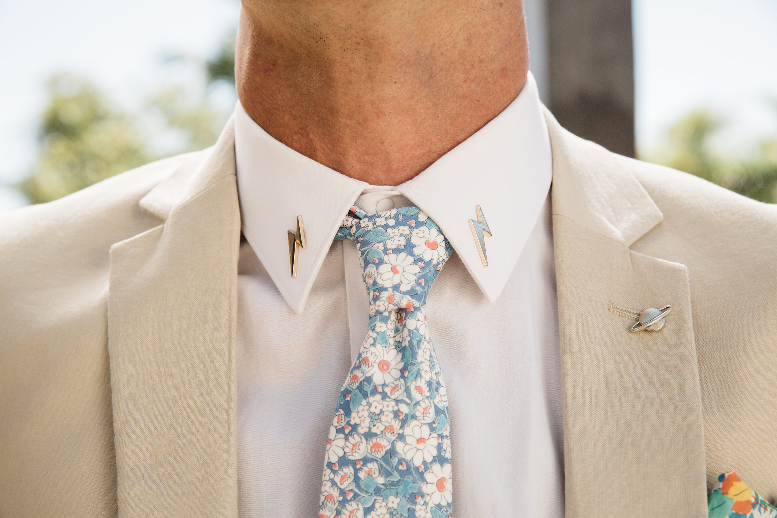 Jesse is one of our all time favorites with his lightning bolt collar pins, his colorful accents on his tie and pocket square, to his funky shoes and retro shades. His style pops!