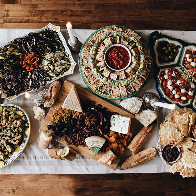 """We've got all your grad party goodies, and a couple different ideas for catering! 1. The whole shebang: antipasti, family-size pastas, sides, and your favorite deli case items. Yum. 2. A table of Italian desserts would be fun! Tiramisus, lemon pistachio bars, cheesecakes, truffles! 🍬🍰🍮 3. How about a pizza party? Couple of pepperonis, cheese, and Prosciutto & Arugula so you can nab that """"Best Grad Part Ever"""" title. 4. Or maybe you want to go sandwich style with some Porchetta from @terzompls. We give you all the fixings for a build-it-yourself pork sandwich table. Sounds kinda fun right? (📸: @travel_drink_eat_repeat)  For easy access, we've linked the catering menu in our profile, but you can also order from the takeout menu, or @terzompls' Porchetta menu 😋"""
