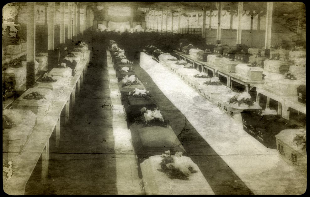 Rows of caskets belonging to the inmates who died in the fire