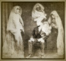 A spirit photo taken by Fredrick Hudson. The sitter was Raby Wootton, who, with friends, took the photograph and developed it themselves without allowing Hudson to take part in it. They never realized how easy it would be for Hudson to switch the plate that he gave them to develop!