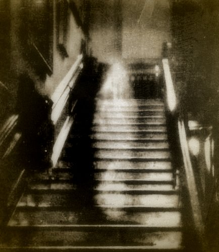 "One of the most convincing photographs was the famous image of the ""Brown Lady"" of Raynham Hall in Norfolk, England. The photo was taken Captain Provand, a professional photographer, who was taking snapshots of the house for Britains  Country Life  magazine in September 1936. His assistant, Indre Shira, actually saw the apparition coming down the staircase and directed Provand to take the photo... even though the other man saw nothing at the time. The resulting image (shown here) has been examined by experts many times, although no explanation for it has ever been given."