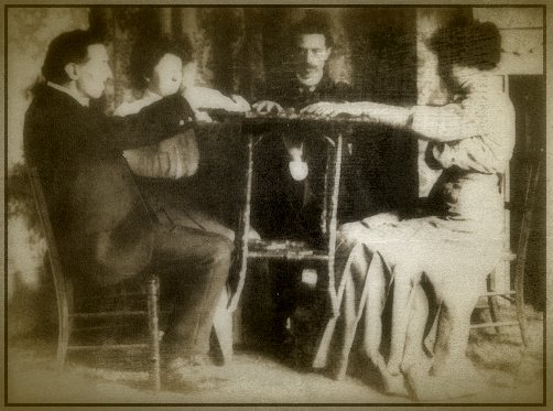 Marriott photographed a number of experiments for Pearson's Magazine. In this photo, he showed how small tables could be easily levitated with nothing more than his foot -- which was virtually undetectable in a dark room.