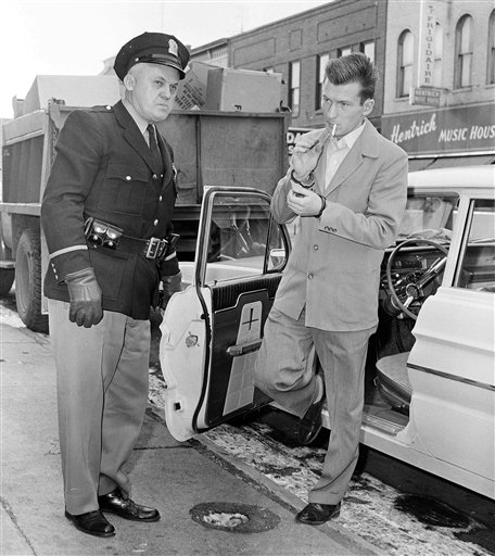 Chester Weger stepping out of a car.