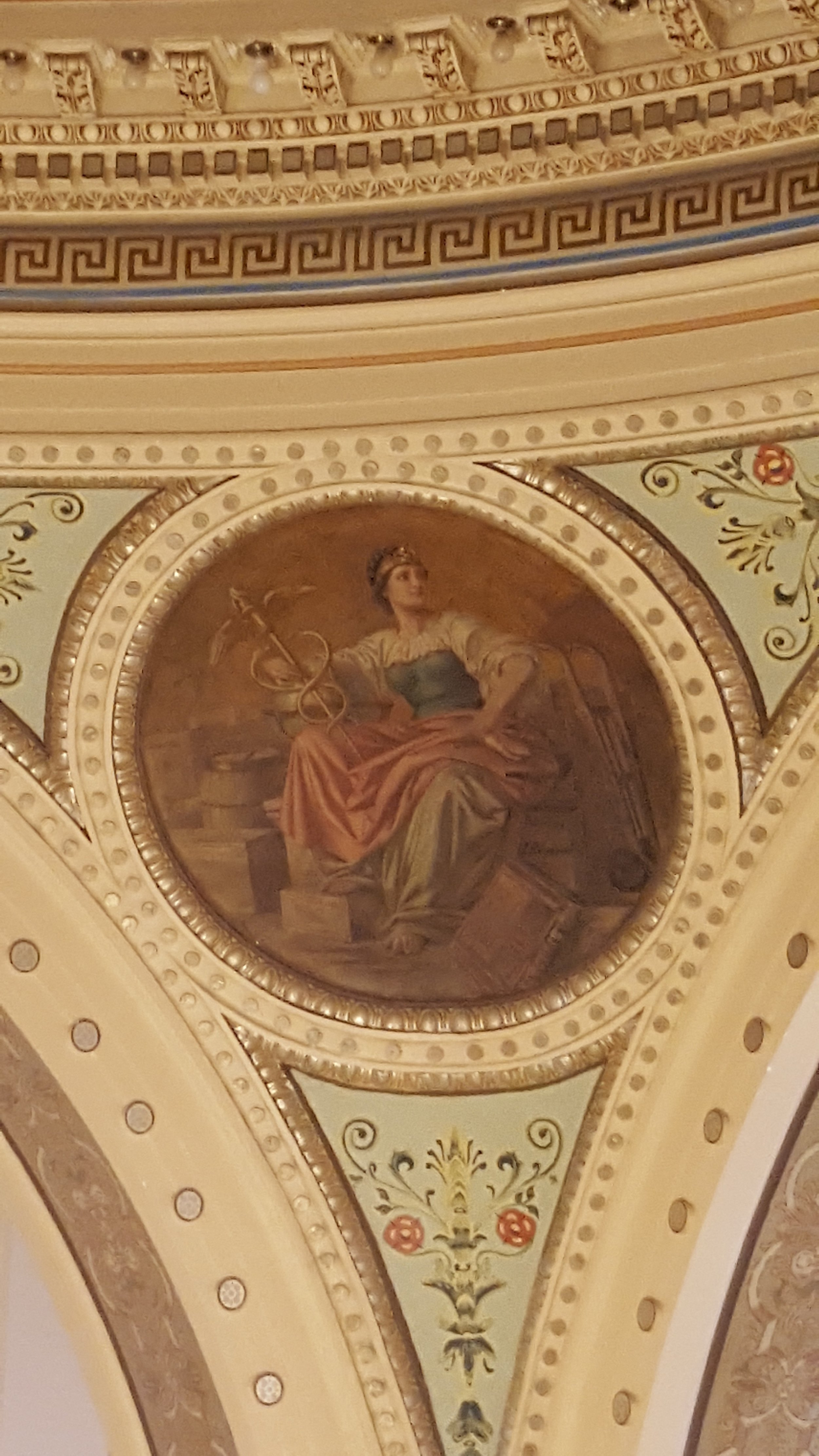 The Medicine medallion by Franz Rohrbeck is located in the domed Rotunda at the Manitowoc County Court House.
