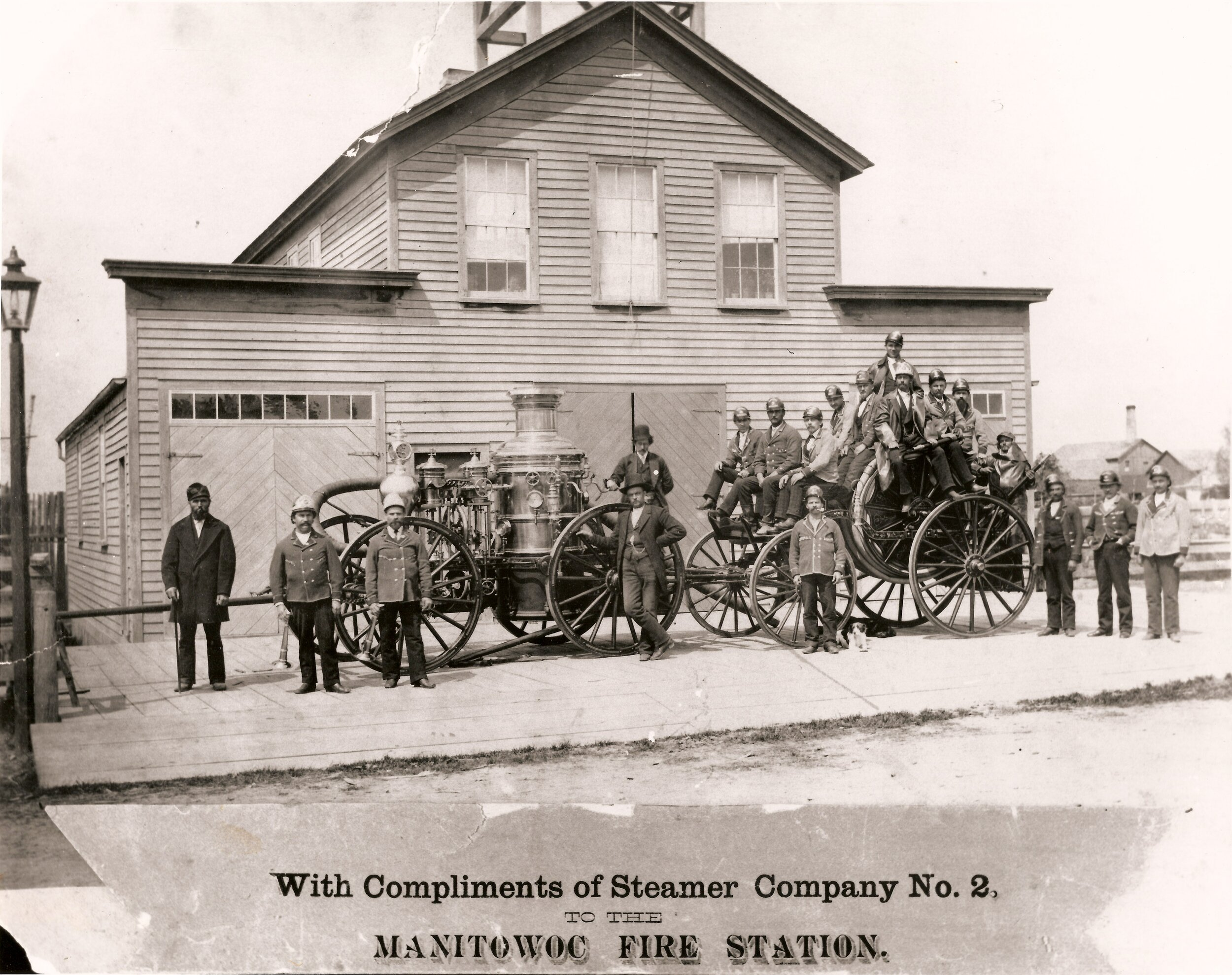 Steamer Company No. 2 in front of the North Side Firehouse on Commercial Street, Manitowoc, early 1900s.
