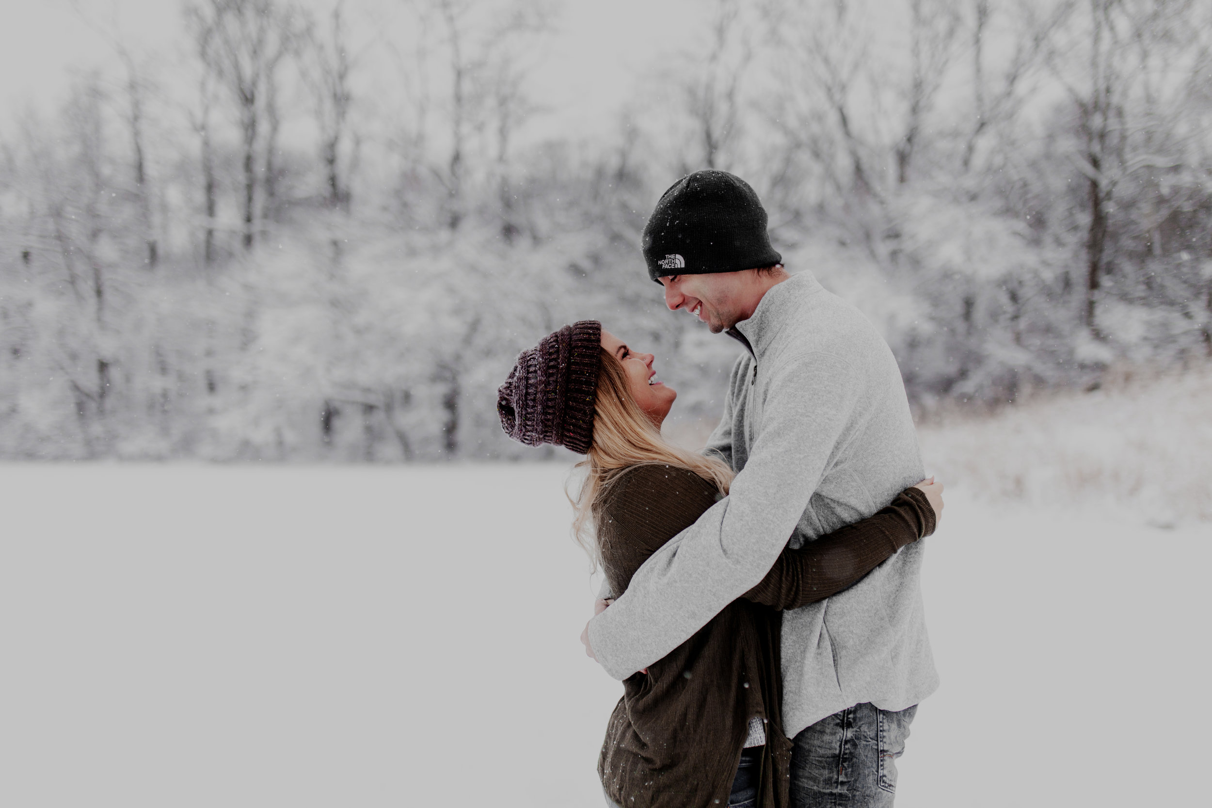 Kirstin + Brandon - January 2019 — Kirstin and Brandon were brave enough to go out in a crazy snow storm with me. We celebrated their engagement by taking some dreamy snow pictures. I've been friends with Kirstin since high school so it was extra special to be part of their experience.