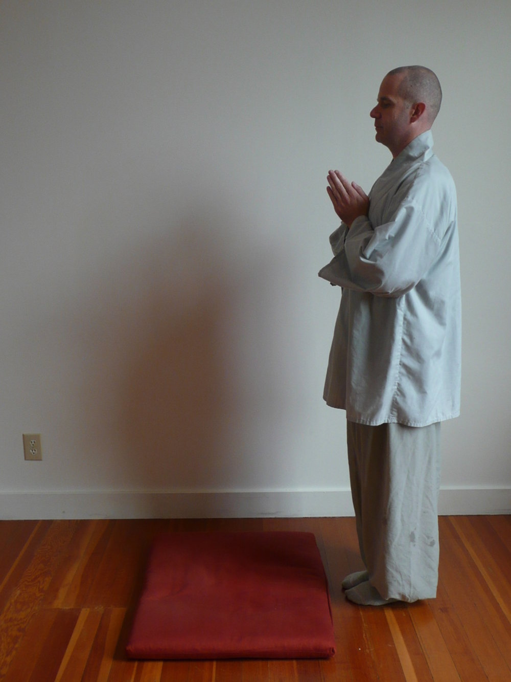 3. Return to standing position. -