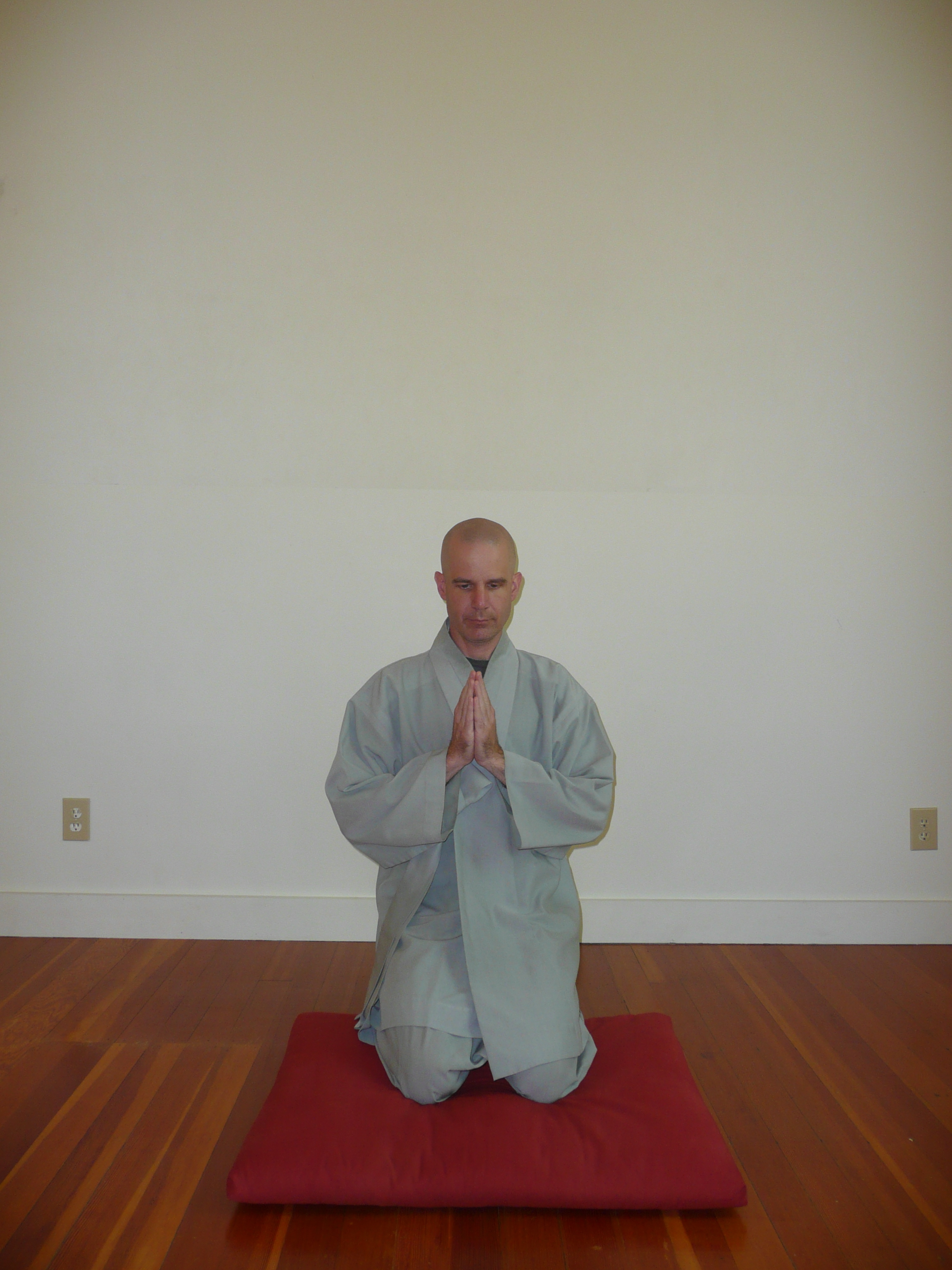 2. Drop gently to your knees, but still stay in a vertical position sitting on your heels with your hands in hapchang. -