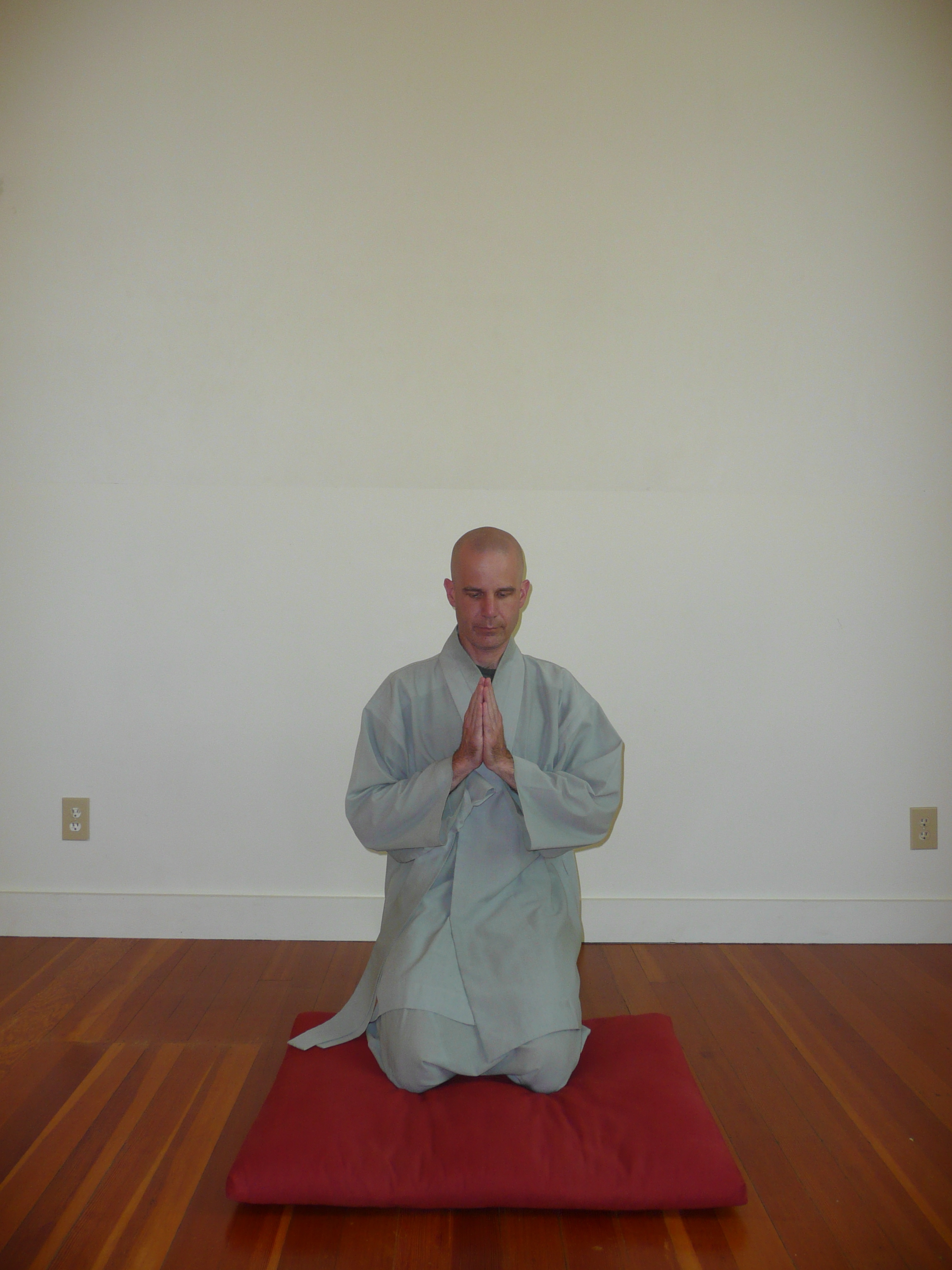 6. Sit back on your heels and come to a vertical position with your hands in hapchang, resting on the balls of your feet again. -