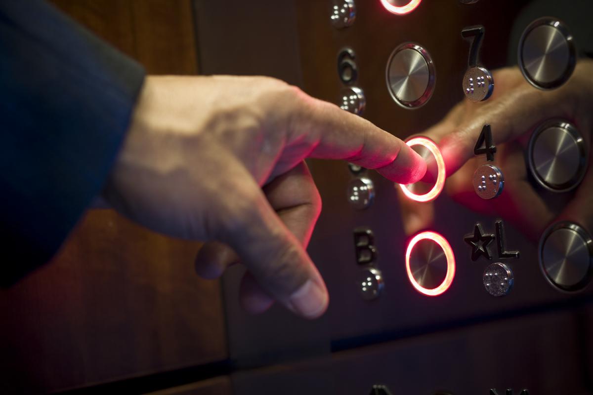 hand-pressing-elevator-button.jpg