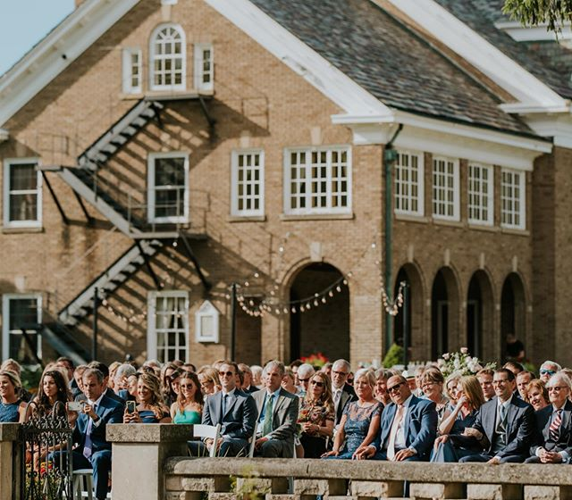 "All of Ashley + Max's favorite people watching them say ""I Do"" 💕  Take a second to zoom in at that front row. Max's parents proudly taking photos (I'd be doing the same thing if Lucy was getting married lol) and both sets of Ashley's parents looking so happy 😭 I seriously love this photo. May we never take for granted all the people who support us on our wedding day. #katetouzelphotography"