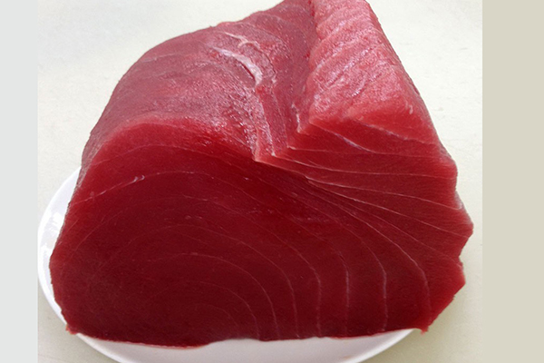 """AHI TUNA If you're looking for the freshest-never frozen Ahi, otherwise known as """"Yellowfin Tuna"""" is flown in overnight from Hawaii. Premier choice for sushi lovers. Among the largest in the tuna species, its purplish flesh is blood line removed and center cut. Ahi's sweet meat is great seared and left rare on the inside, or grilled."""