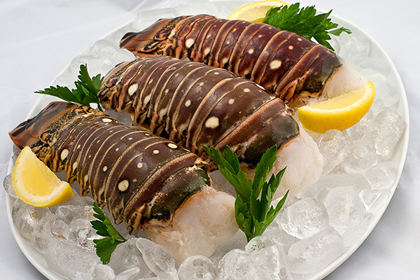 WARM WATER LOBSTER TAILS These tender, mouth-watering warm water lobster tails are a true delicacy. A feast fit for a king and queen.