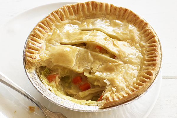 """TUNA POT PIE 5"""" pie crust filled with tuna, vegetables, and Béchamel sauce then topped with puff pastry."""