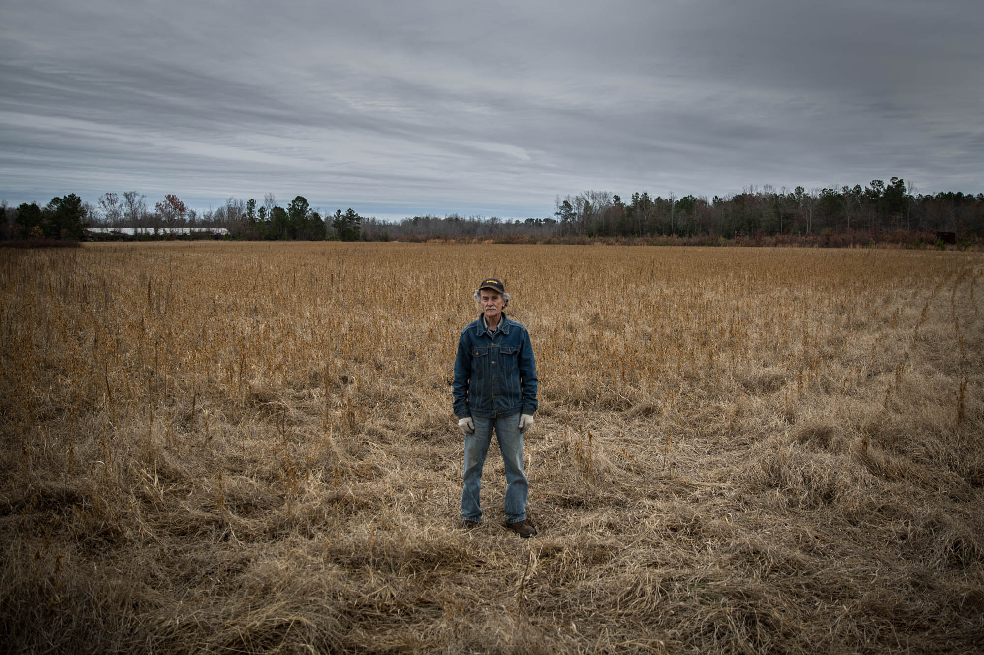 """Winstead poses on his farm. He says that the most outrageous part of all of this is that his rights are being taken away. He views it that the government is taking his land to give to a private company, which is not the point of eminent domain. One of his activist colleagues discusses how the power companies basically told him that he was expendable. """"I'm just upset because it's my community,"""" he said. """"We're not expendable."""""""