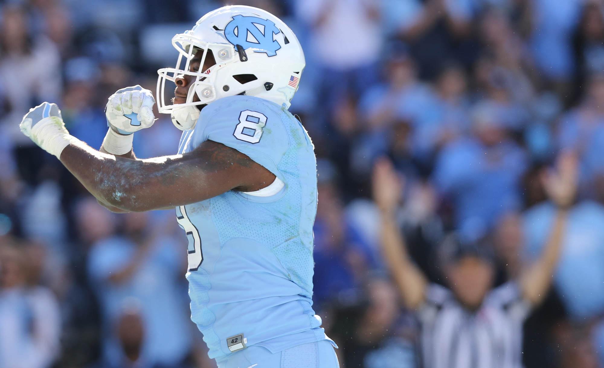 North Carolina Tar Heels tailback T.J. Logan (8) celebrates after a touchdown against the Georgia Tech Yellow Jackets at Kenan Stadium at Chapel Hill, NC on Saturday Nov. 5, 2016.