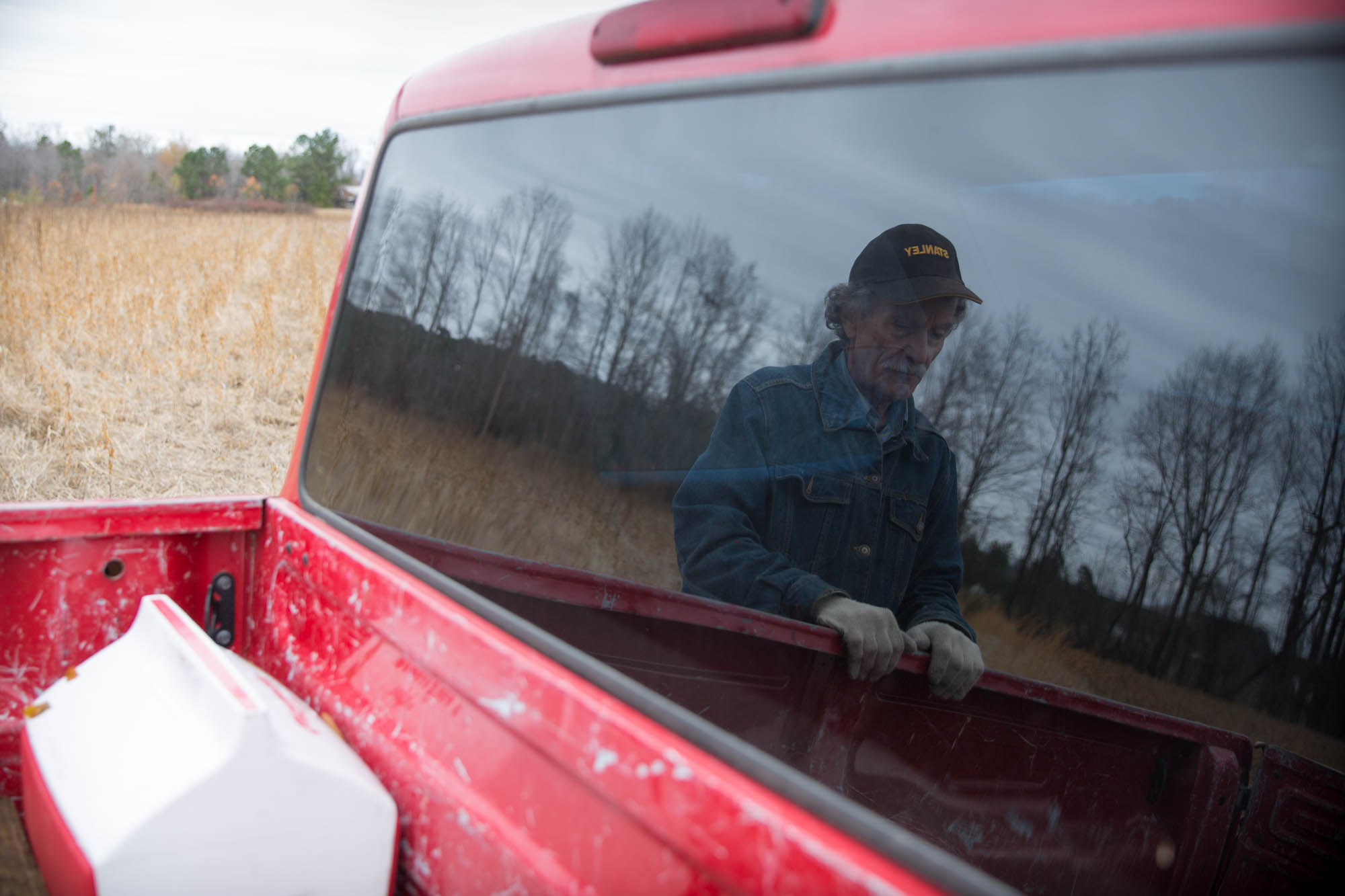 """Winstead stands at his truck as he gets ready to show his farm. This year, he rented out his land to a neighbor, and did not plant any crops of his own. """"I've spent so much time doing pipeline stuff, I didn't have any to put towards farming,"""" he said."""