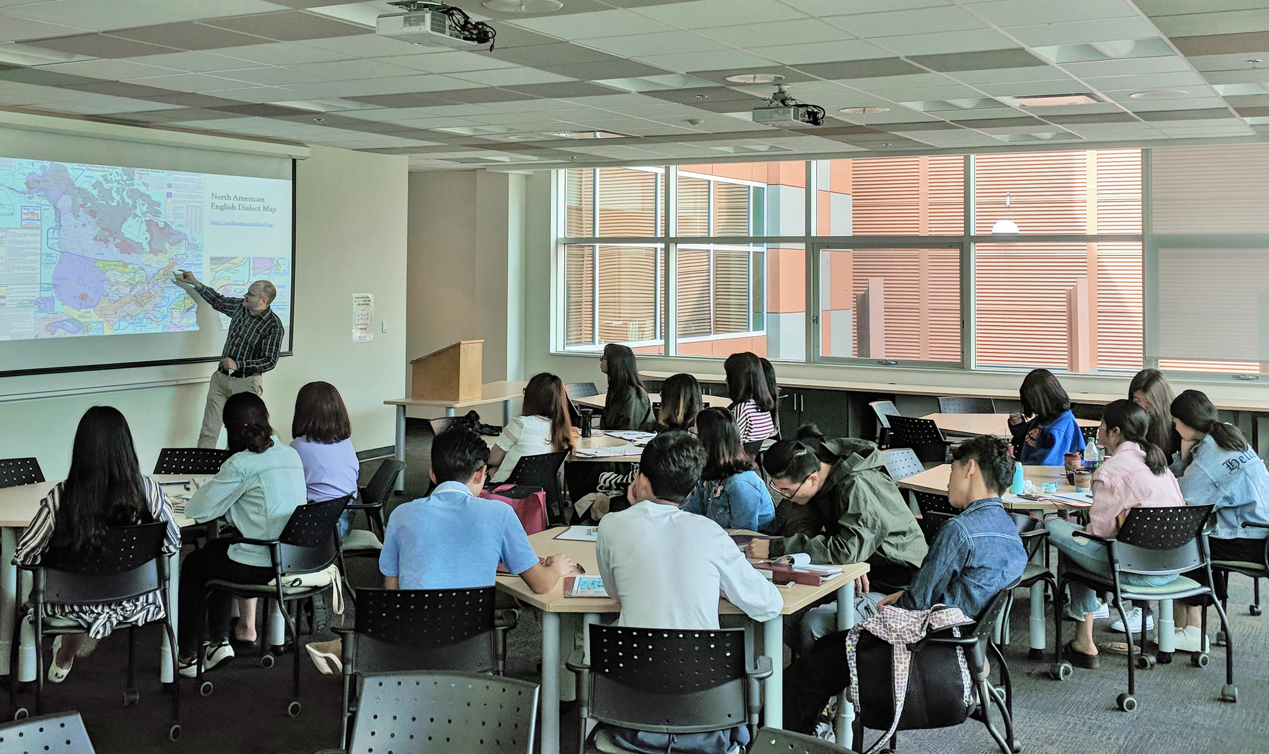 Dr. Eric Henry presents a lecture exploring linguistic variation at the Summer Institute