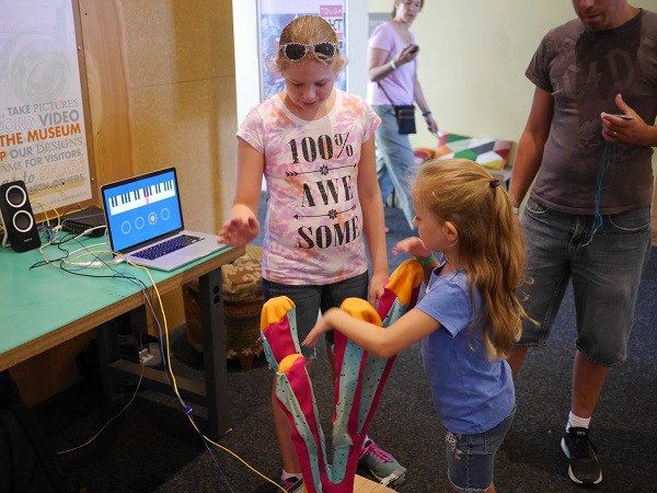 """Kids experiment with a prototype of """"Urchin Searchin Sound."""
