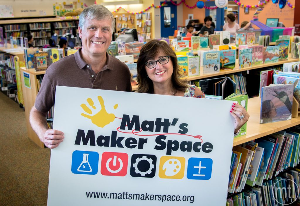 David and Noelle Conover stand inside the children's wing of the Mt. Lebanon Library.