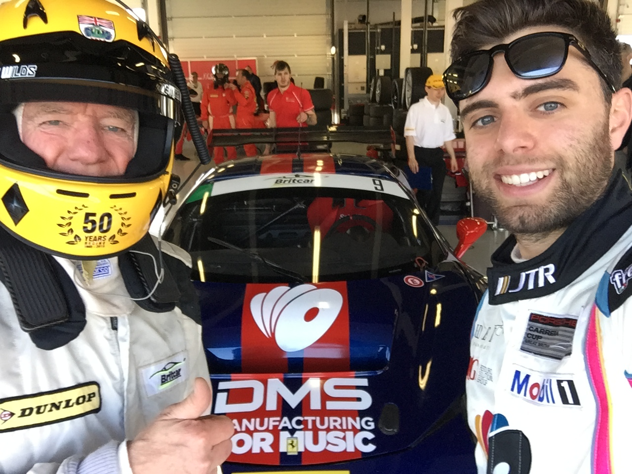 Mike, 71, and Dino, 24, enjoy a selfie before the races