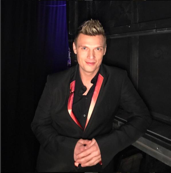 Nick is wearing a Haider Ackerman jacket and Dolce&Gabbana shirt.