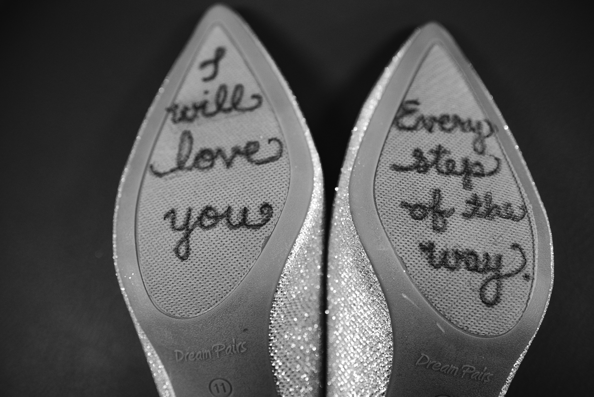 Brides shoes that have a saying on them