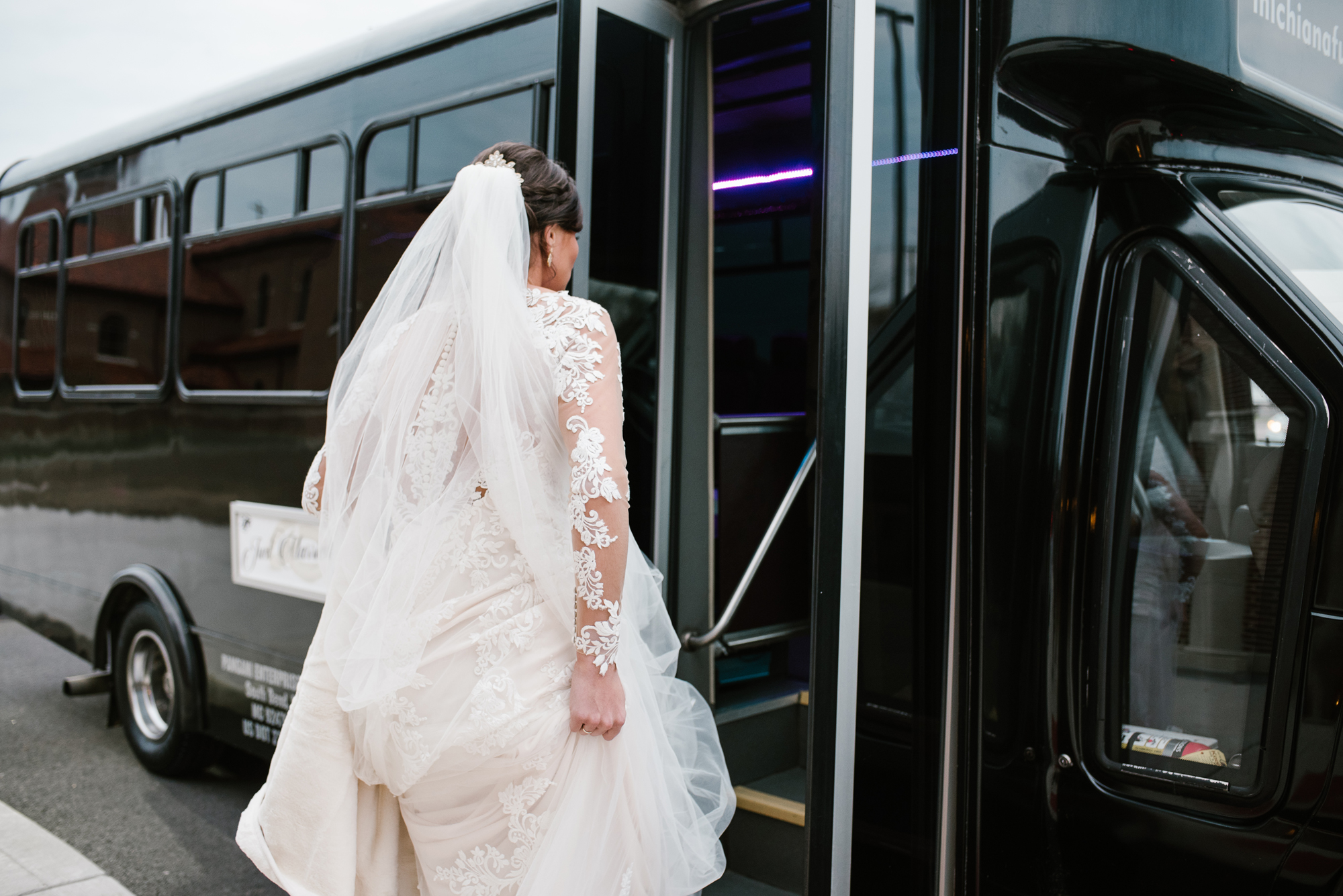 bride getting into party bus