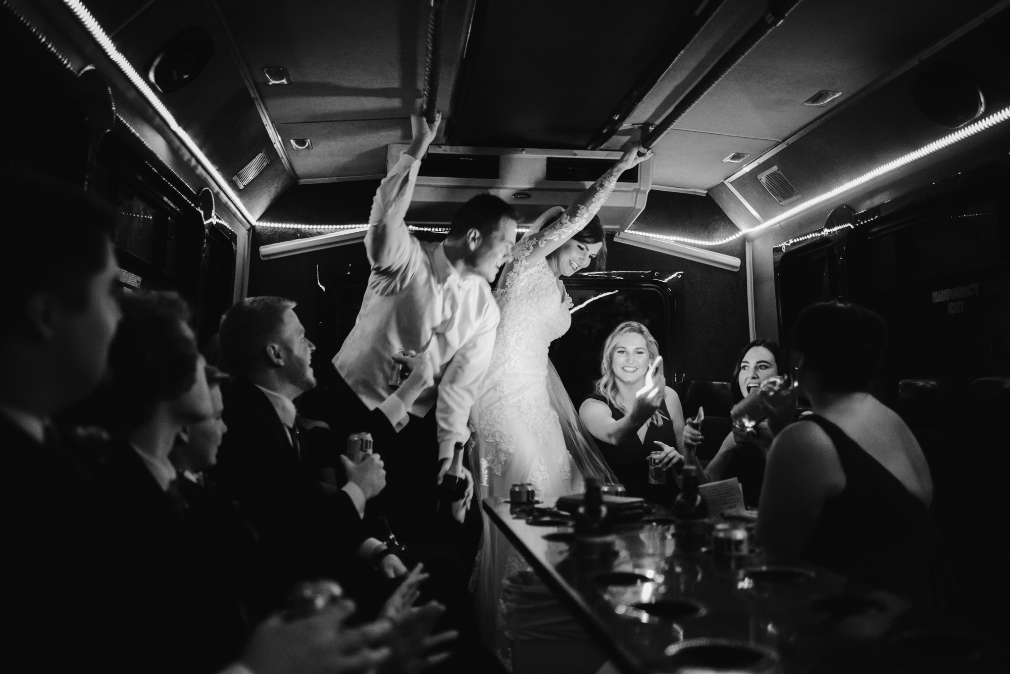 bride and groom on party bus