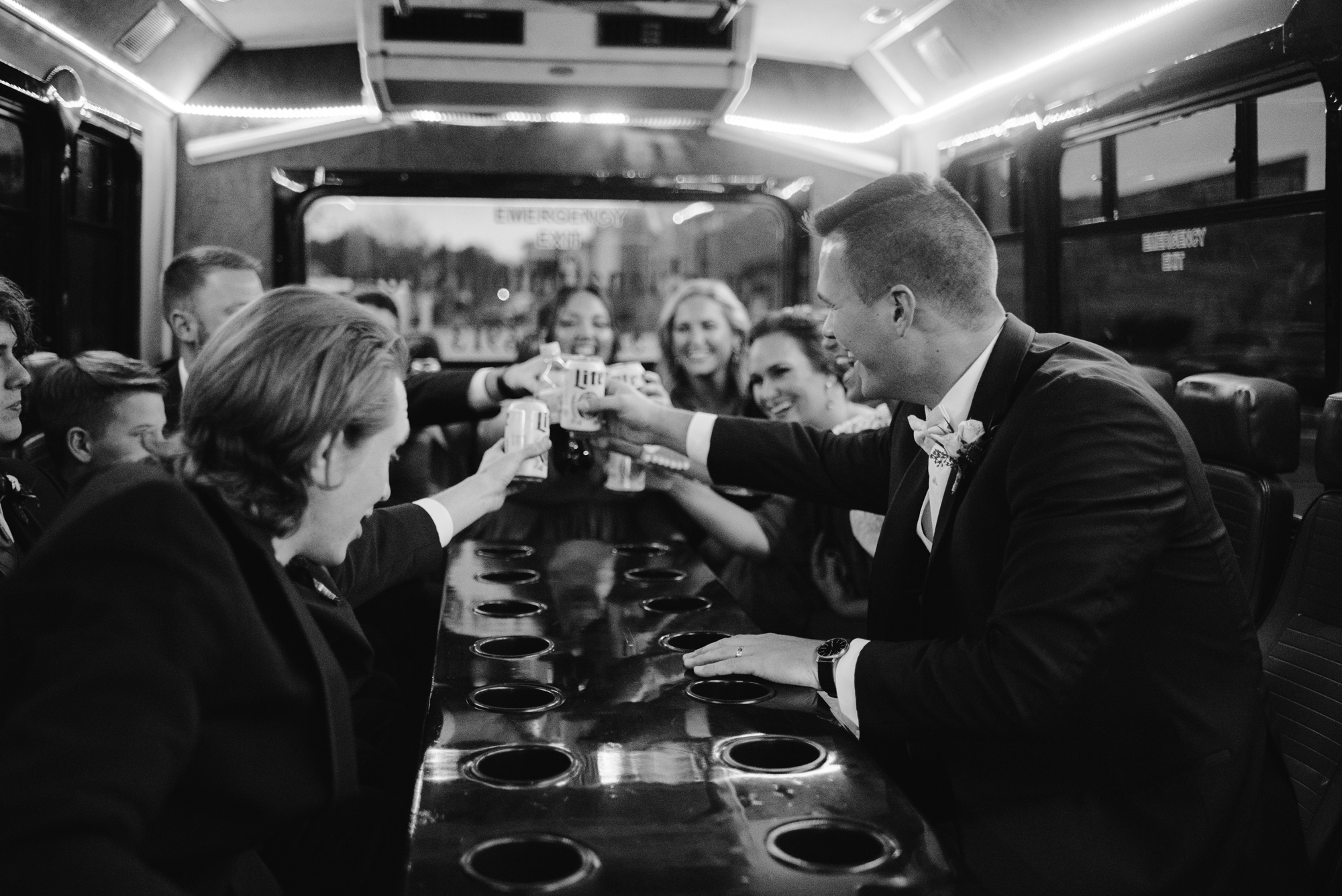 bridal party cheers on party bus