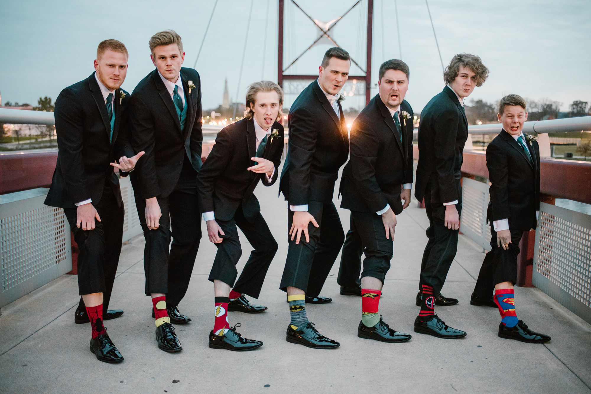 groomsmen show off socks for picture