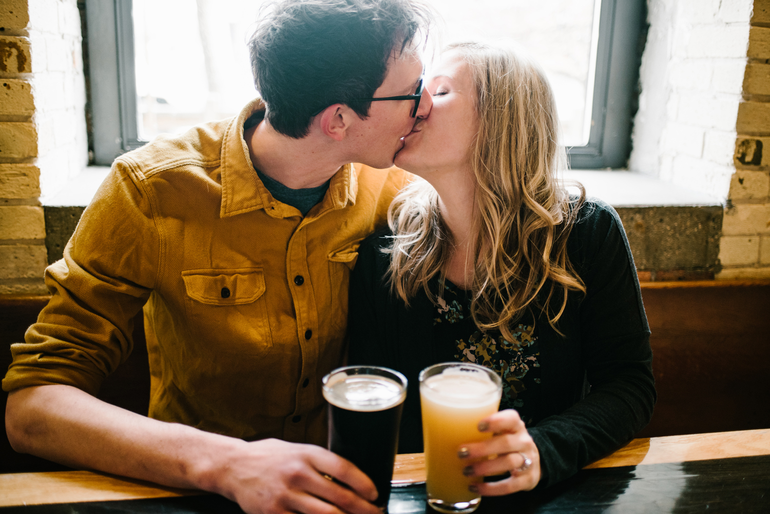 couple kissing at brewery in grand haven michigan