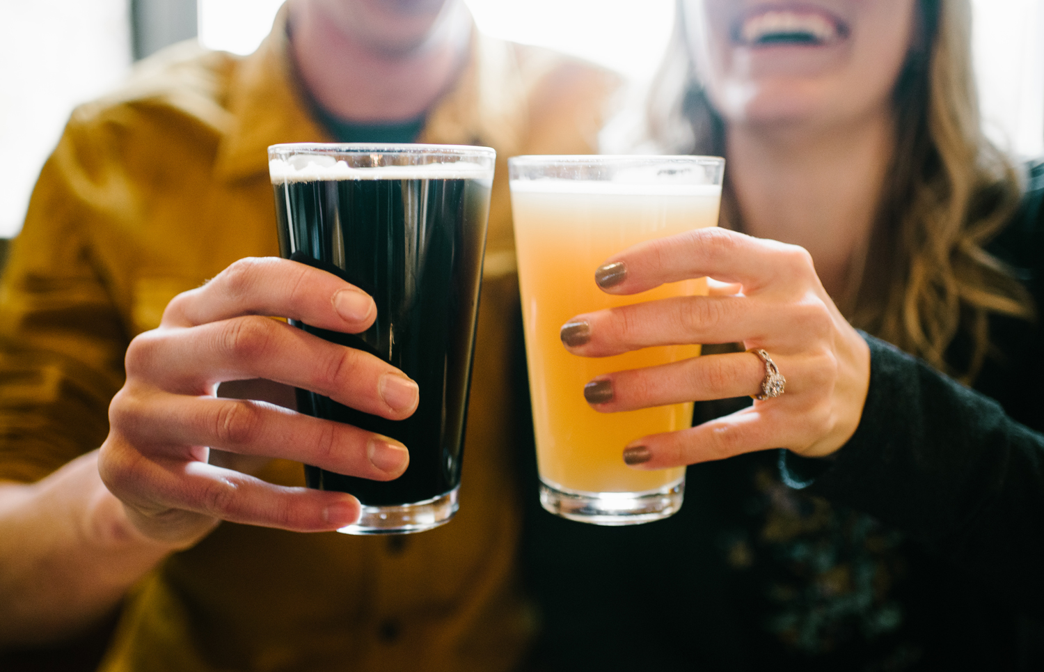 engagement photo with craft beer