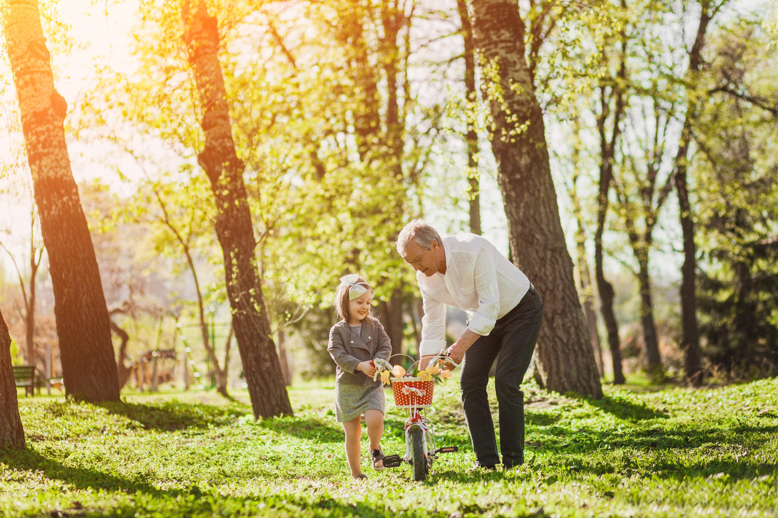 Grandpa with girl and bike.jpeg