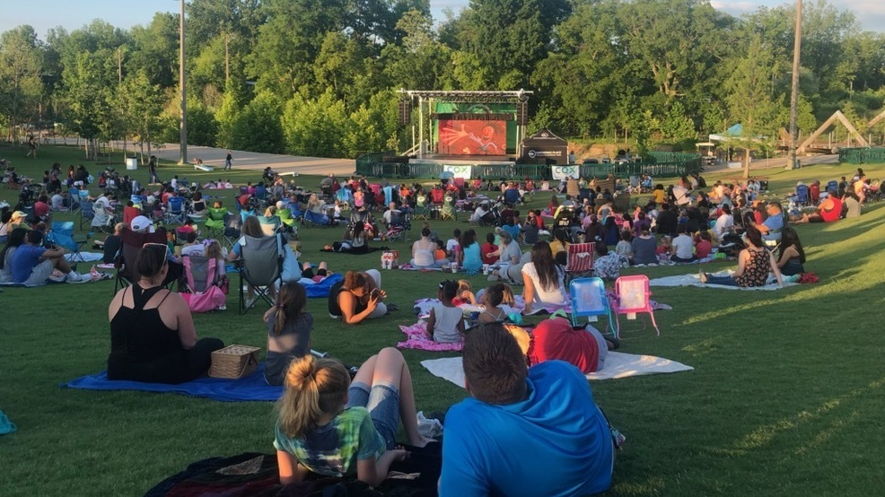 People watch a movie June 19, 2019, at the Gathering Place in Tulsa, Okla. (KTUL photo)