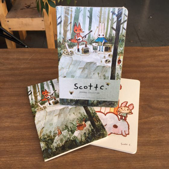 Scott C. journals $15   These journals are filled with blank pages for you to be creative within, but they are housed in some Scott C paintings there on the inside and outside covers.  It will be like we are out drawing together when you take these on trips!