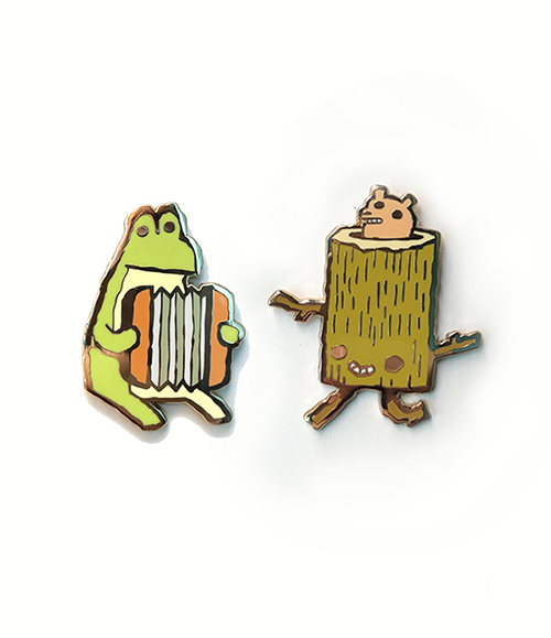 """Accordian Frog"" and ""Log Runner"" pins - $10 each   This little frog would love to play accordion on your lapel or backpack. The Log Runner is often found cruising through thickets and meadows on it's way to some forest party. Excited little Log Runners. This one has a little animal riding inside it. Log Runner would look perfect on the straps of your backpack or even pinned to your tent!"