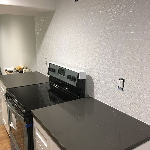Loving how this kitchen is coming together! • • • • • #kitchen #quartz #tile #white #grey #remodel #apartment #smallspaces #makethemostofit #fixerupper #rental #tile #backsplash #detail #design #interiordesign #clean #granite #build #nofilter • • • • • @blancoamerica1 @jandkcabinetry @whirlpoolusa @caesarstoneus
