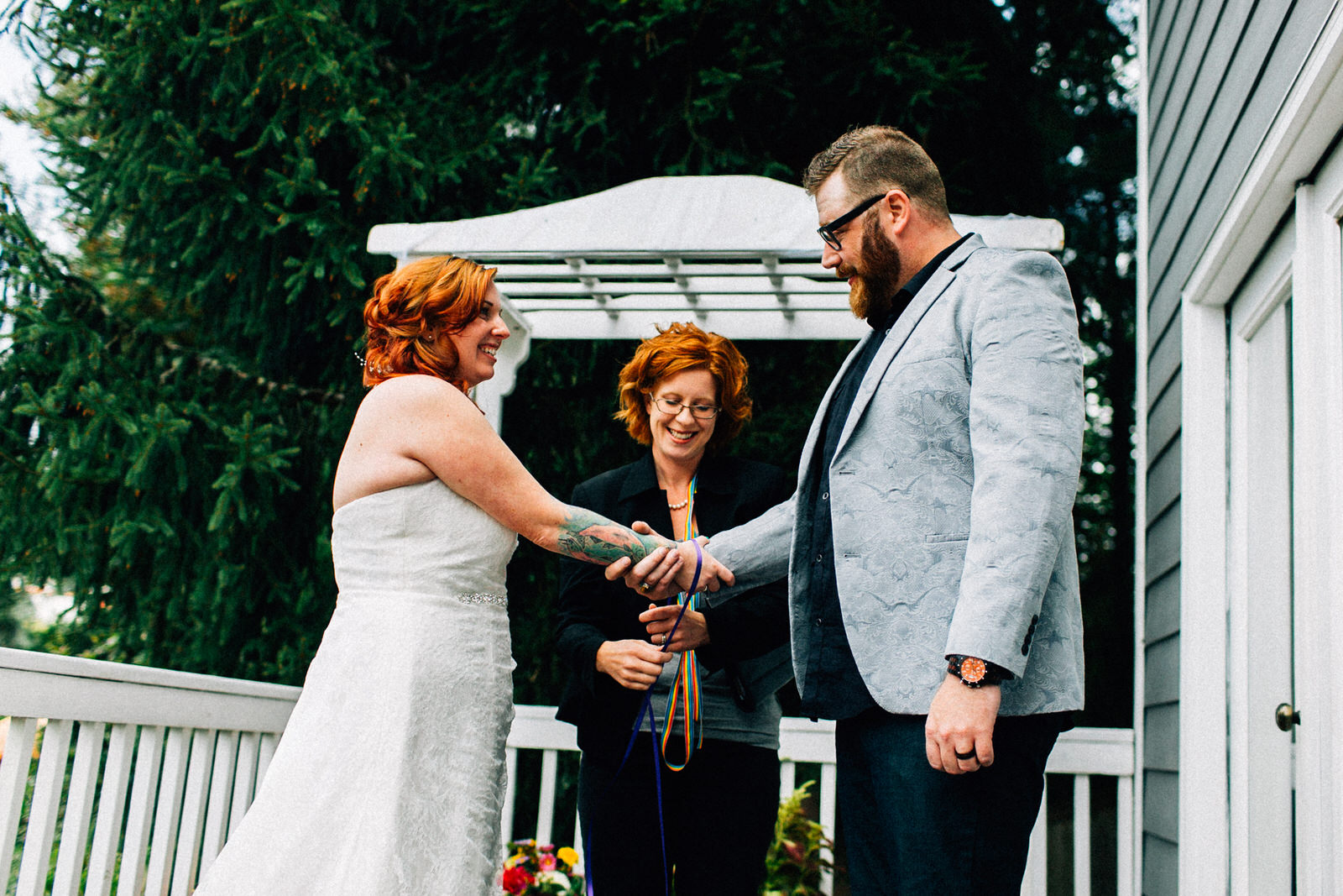 tracey chris seattle backyard at home wedding fuck yeah weddings kendall lauren shea photographer feminist ceremony hand fasting wildflower bouquet tacoma portland deck