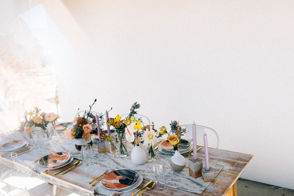 palm springs joshua tree elopement wedding styled shoot fuck yeah weddings feminist photo vaycay kendall lauren shea floral arrangement table arch alter lesbian lgbtq couple of color
