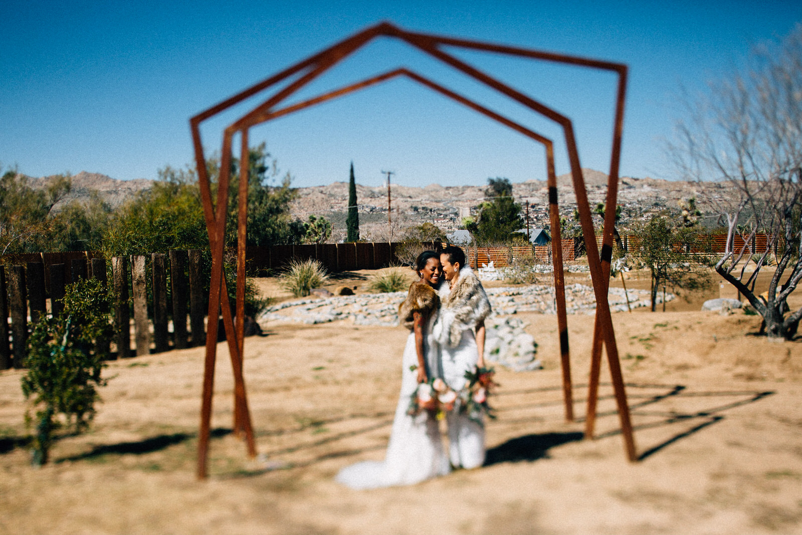 palm springs joshua tree elopement wedding styled shoot fuck yeah weddings feminist photo vaycay kendall lauren shea floral table arch alter lesbian lgbtq couple of color seattle photographer