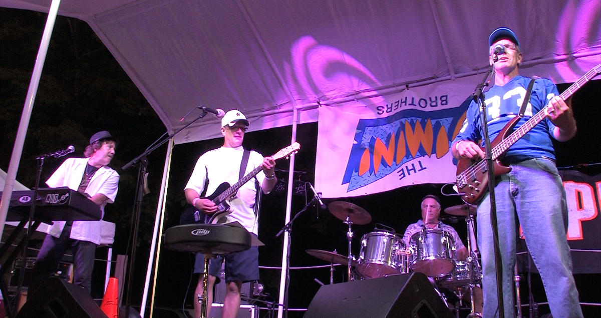 Dennie Middleton, Jeff Okkonen, Brad Franck, and Nick Lewis (left to right) on stage at the Sparta Beer Tent in 2016. Everett Domeier is just out of the frame to the right. Sorry, Ev!