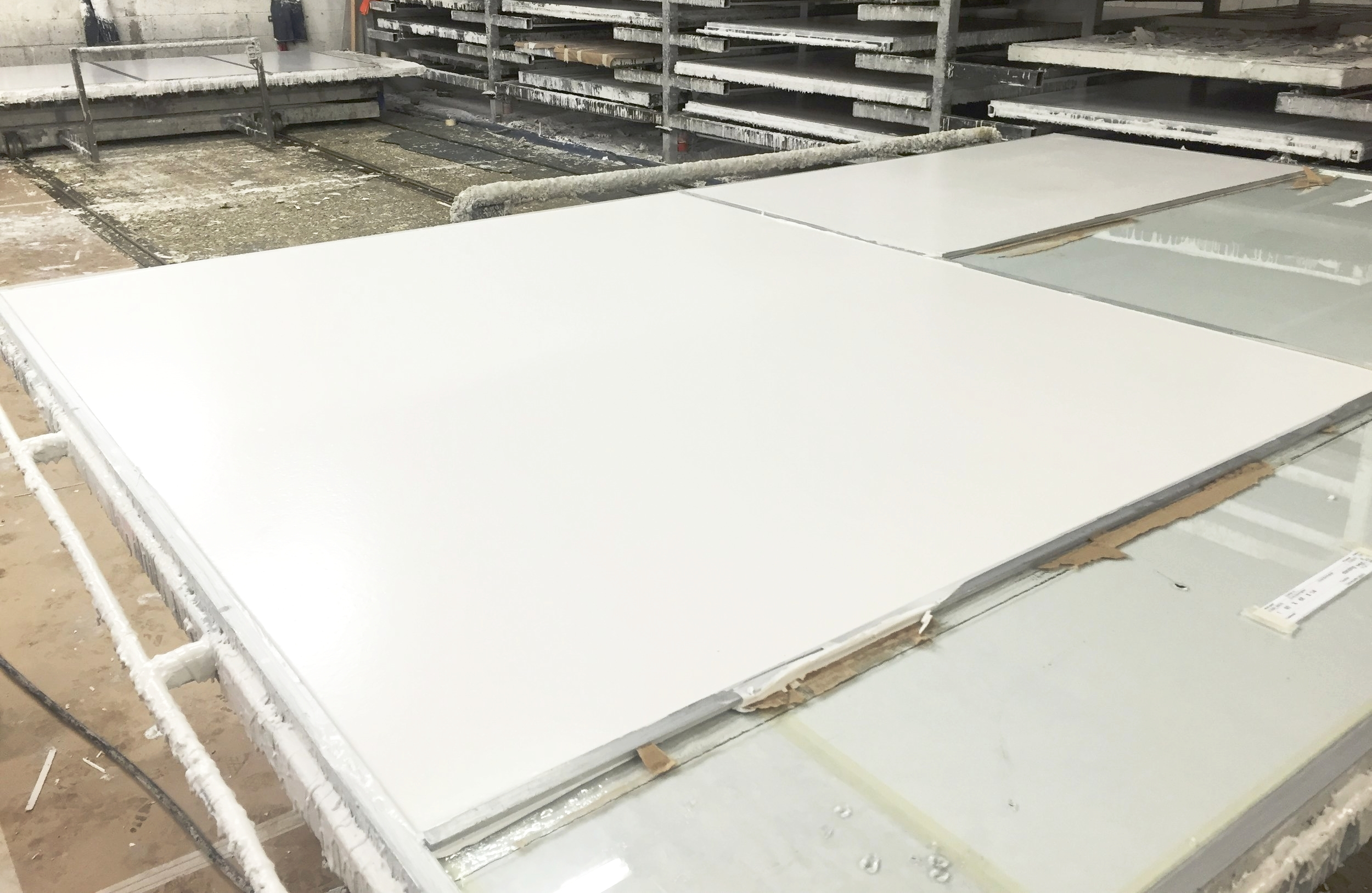 A completed panel with the white marble matrix backing.