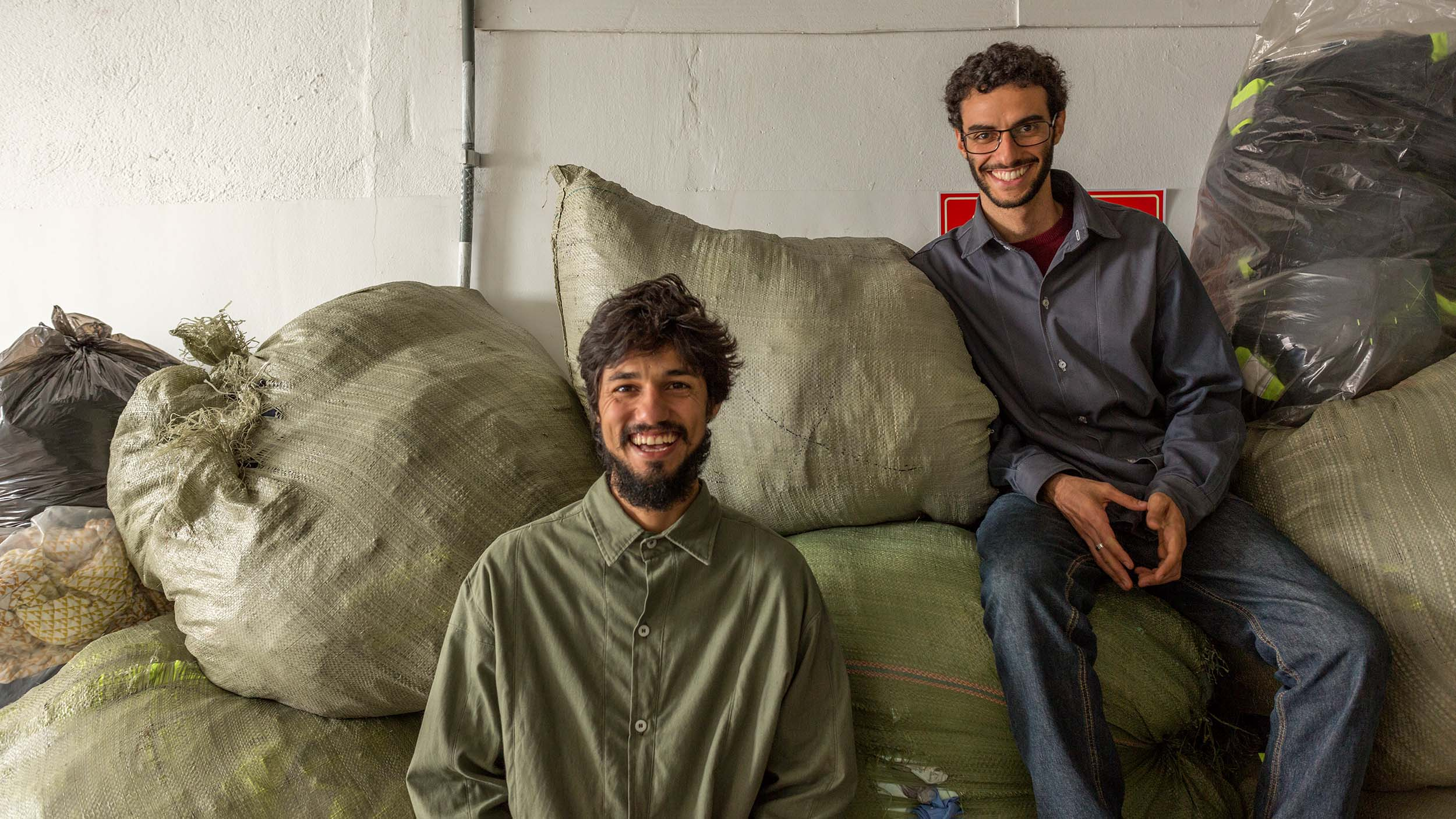 Retalhar Founders Lucas Corvacho (L) and Jonah Lessa (R) met while working in the impact reduction department at Lutha Uniformes, where they identified a market need for recycling used uniforms in Brazil.