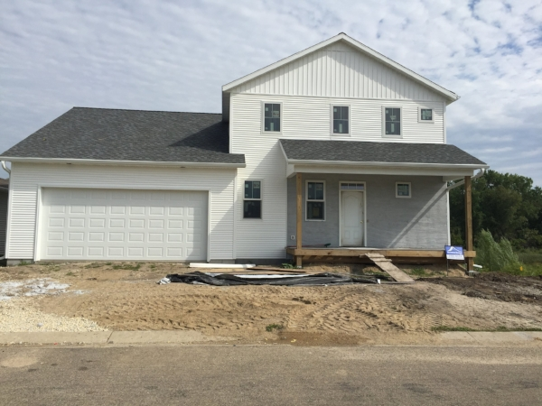 Modern farmhouse new construction At Hadley Creek   General Contractor: Hammer Homes  Design: Dwell Local