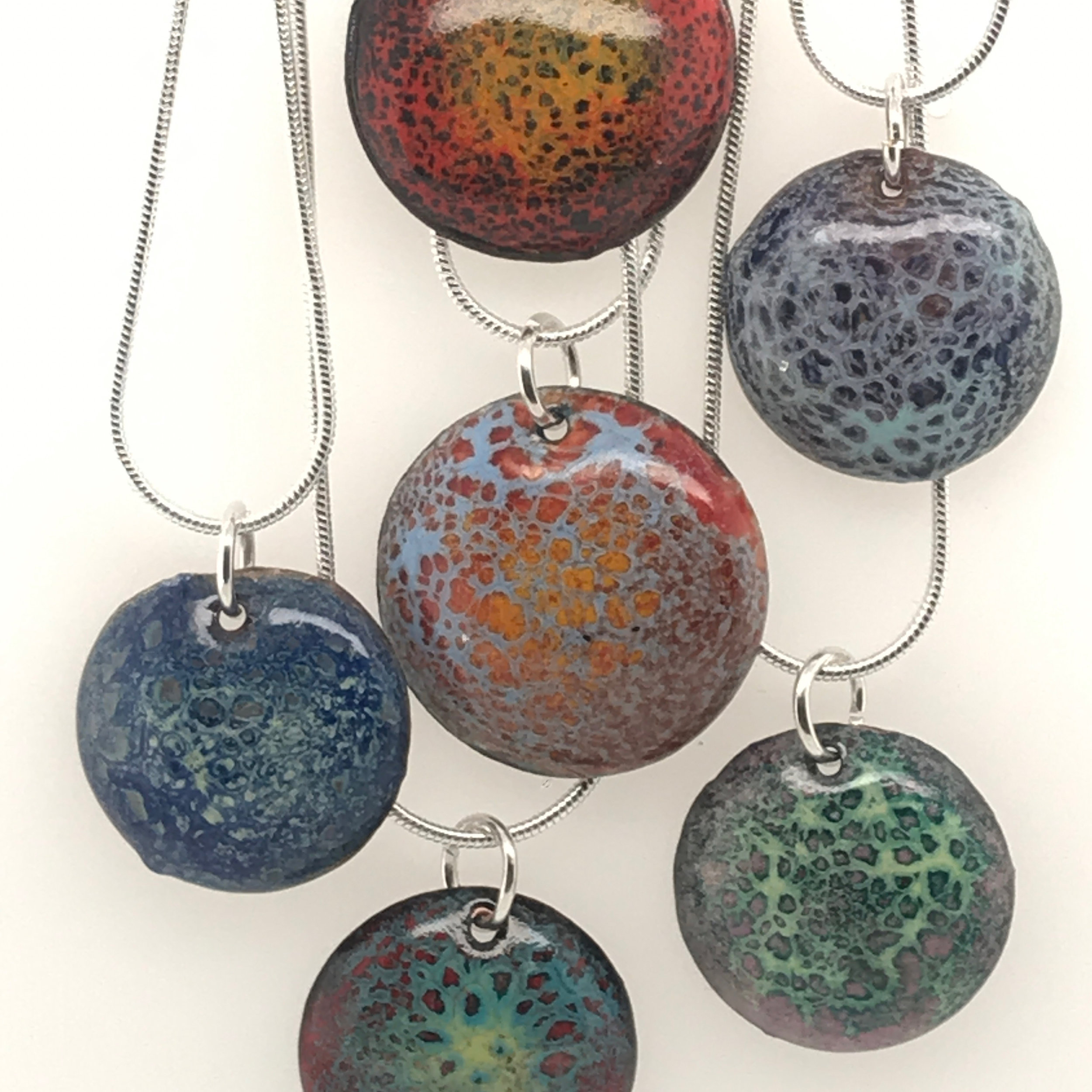 dwell local studio ~~ classes   Pre-registration is required, please call (507)202-3815   It's a Charming Thing, Movement and Glass — with Amy Johnson    Wednesday, June 19th @ 6pm-9pm   Lets Experiment!!! Do you want to see glass move? Crackle? Divide? In this class you will play with enamel which is powdered glass and experiment with reactions. You will learn that each enamel colorant has a different expansion rate. You will then learn through your experiments how combining a low expansion rate enamel called crackle with different colors and temperatures can make glass move differently. Come and play with movement and glass! Learn the art of enameling, the process of binding powdered glass to a metal surface. In this class, you will learn basic enameling skills. You will learn how to sift powdered glass onto copper. You will then heat and melt the powdered glass by the use of a Mapp gas torch. At the end of this class you will have acquired various charms that you have made through your experiments. You will attach jump rings to your charms and I will provide a 18 inch chain so you can alternate and wear your charm pendants. Students should wear closed toe shoes, natural fiber clothing and have their hair tied back. $50 class fee includes all materials. Pre-registration is required, please call (507)202-3815   Follow us on facebook and instagram for more up to date info…