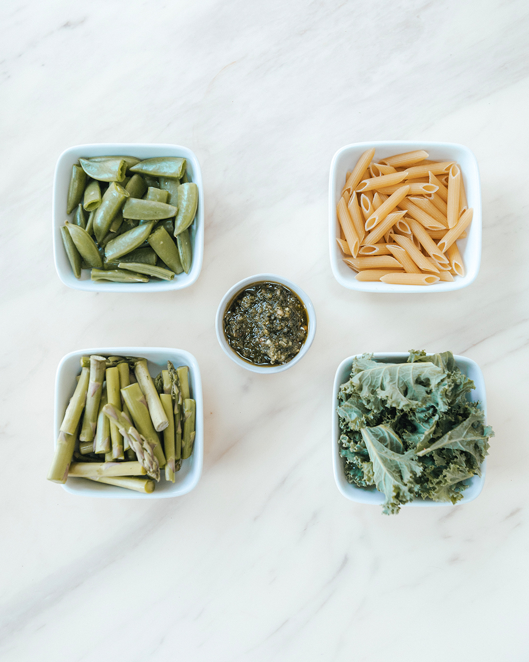 The-Oily-Home-Companion-Recipe-Pesto-penne-gluten-free-gf-pasta-spring-vegetables-asparagus-kale-garlic-basil-lemon-vitality-essential-oil-pesto-Summer-Spring-Dish-Meal-Ingredients.jpg