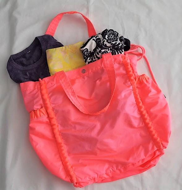 Lululemon  tote bag with Lululemon and ALO Yoga clothes