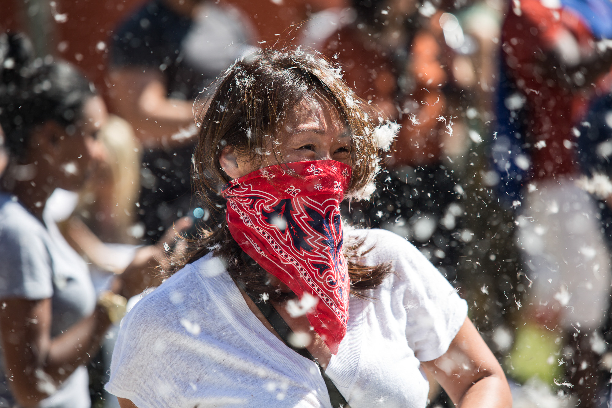 LA local Kris Chen enjoys and takes part in the annual International Pillow Fight Day fight in Pershing Square in Downtown Los Angles on Saturday, April 1 2017. Hundreds of people traded soft blows in a giant pillow fight that dwarfed even the biggest slumber party slugfest. Children, teens, adults and seniors swung pillows at one another for over 2 hours during Saturdays event. (Corsair Photo: Matthew Martin)